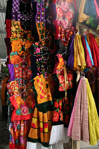 Huipiles: Gorgeous Examples of Authentic Mexican Embroidery - Colorful Huipiles for Sale in a Market
