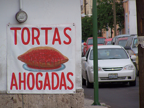 A  Morbid Looking Sign for A Juicy Tortas Hogadas Sandwich In Jalisco